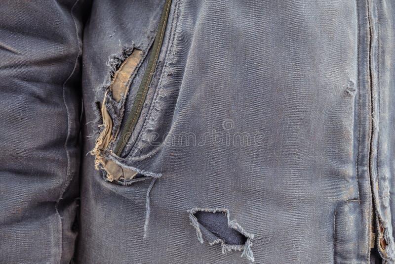 Сорванный outerwear Неровные голубые одежды стоковые изображения