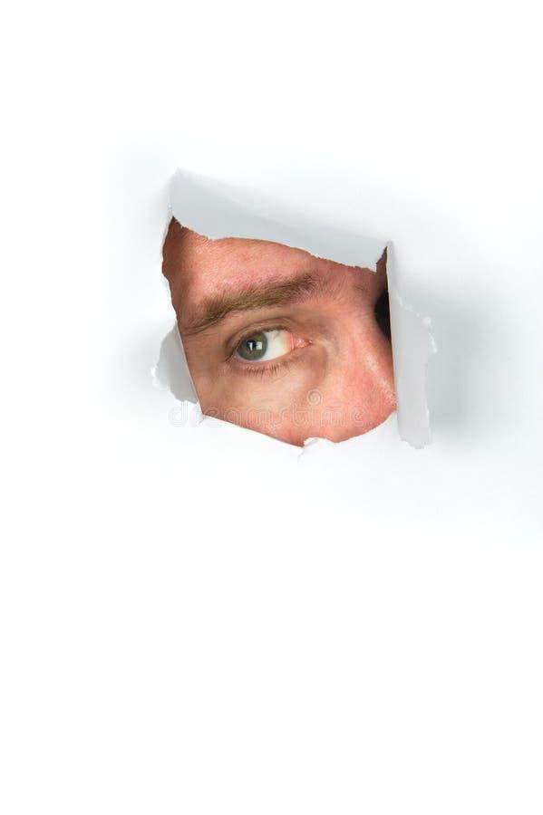 сорванный peeking бумаги человека стоковое изображение rf