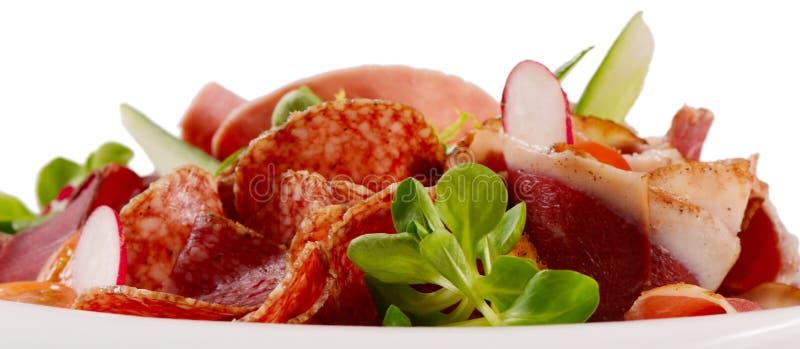 Сортированные итальянские сосиски близко вверх как предпосылка стоковое изображение
