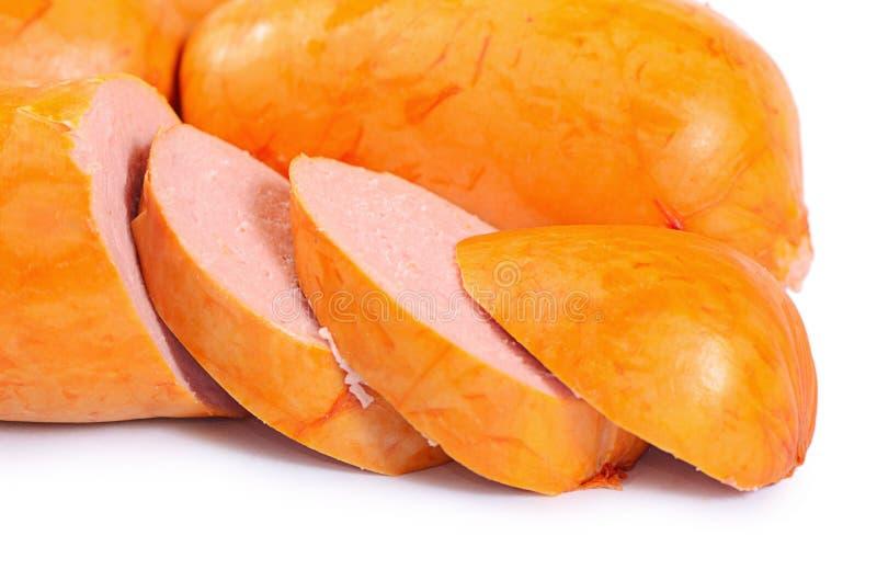 Сосиски мяса изолированные на белой предпосылке стоковое фото