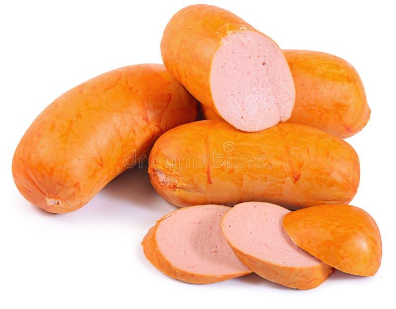 Сосиски мяса на белой предпосылке стоковые фото