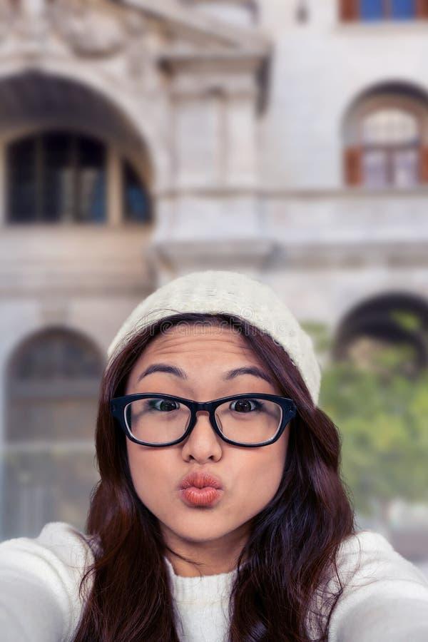 Составное изображение азиатской женщины делая стороны стоковые изображения