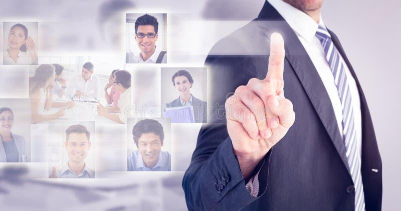 Составное изображение бизнесмена указывая с его пальцем стоковые изображения rf