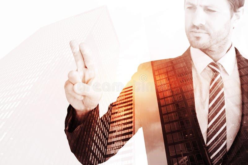 Составное изображение бизнесмена указывая с его пальцем стоковые изображения