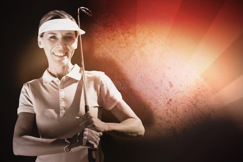 Составное изображение женщины играя гольф стоковое фото rf