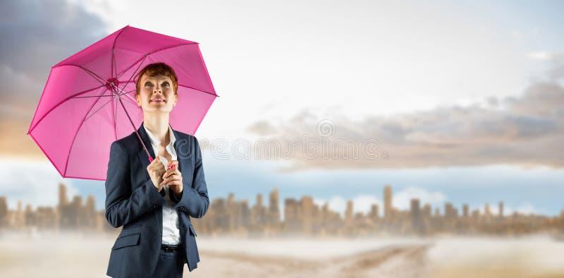 Составное изображение коммерсантки с зонтиком стоковое фото rf