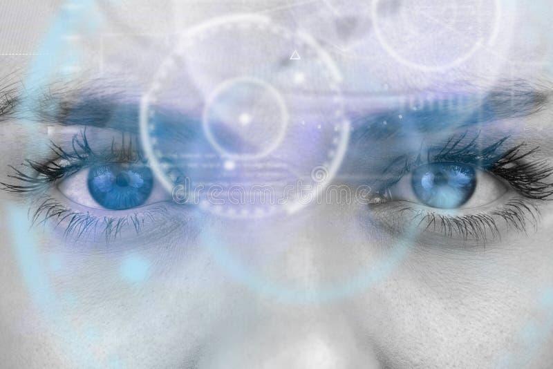 Составное изображение конца вверх женских голубых глазов стоковые изображения