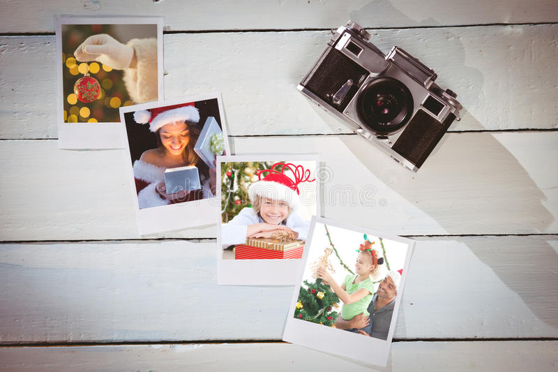 Составное изображение милого брюнет в подарке отверстия обмундирования santa стоковые изображения rf