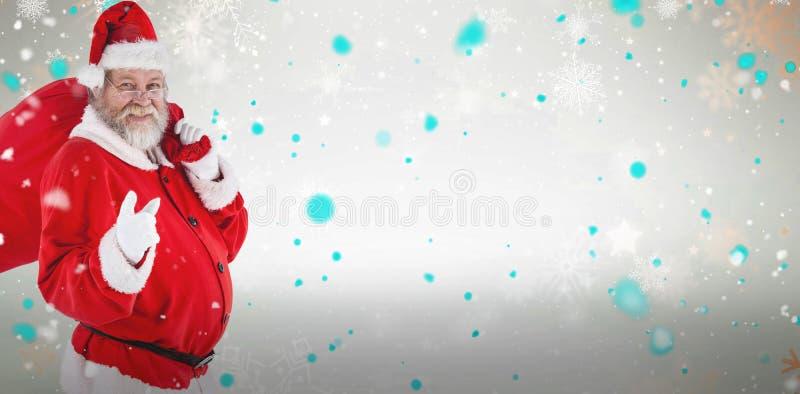 Составное изображение портрета Санта Клауса указывая пока носящ сумку рождества стоковая фотография