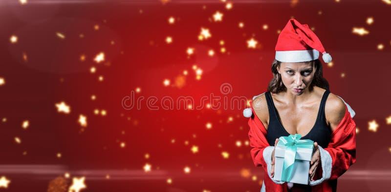 Составное изображение портрета спортсмена в костюме рождества и настоящем моменте держать стоковое изображение