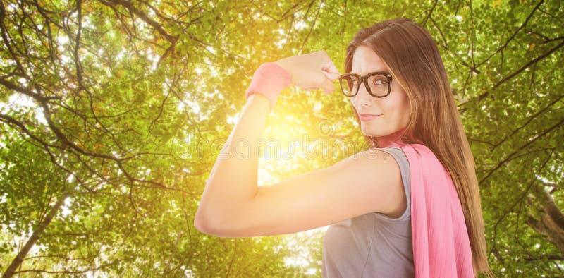 Составное изображение портрета уверенно женщины в костюме супергероя стоковая фотография rf