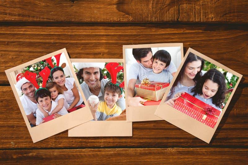 Составное изображение симпатичной семьи давая настоящие моменты для рождества стоковое изображение rf