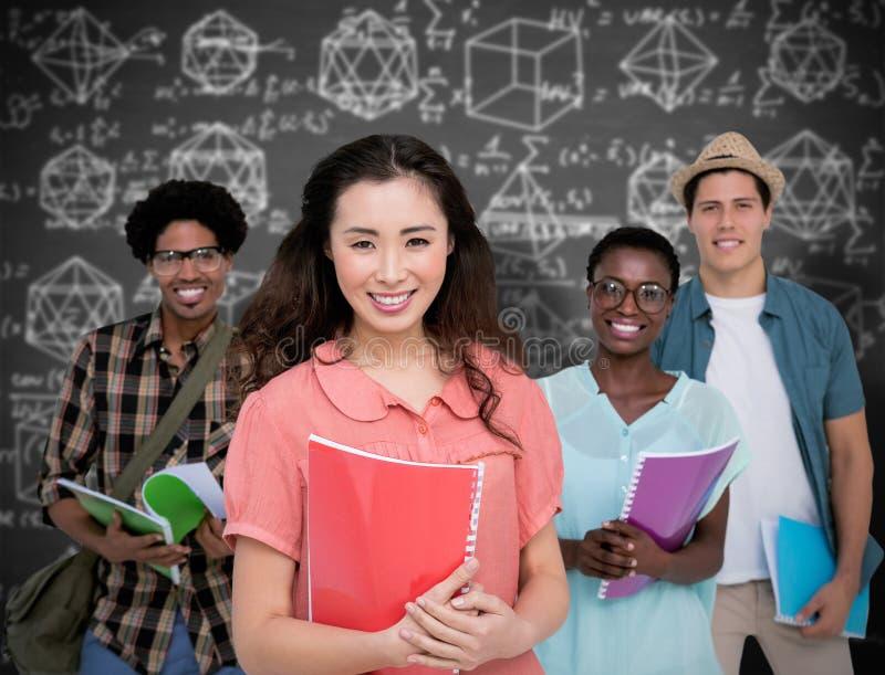 Составное изображение стильных студентов усмехаясь на камере совместно стоковое изображение rf
