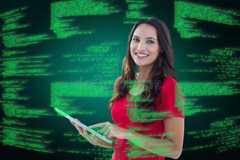 Составное изображение счастливой женщины используя таблетку стоковые изображения