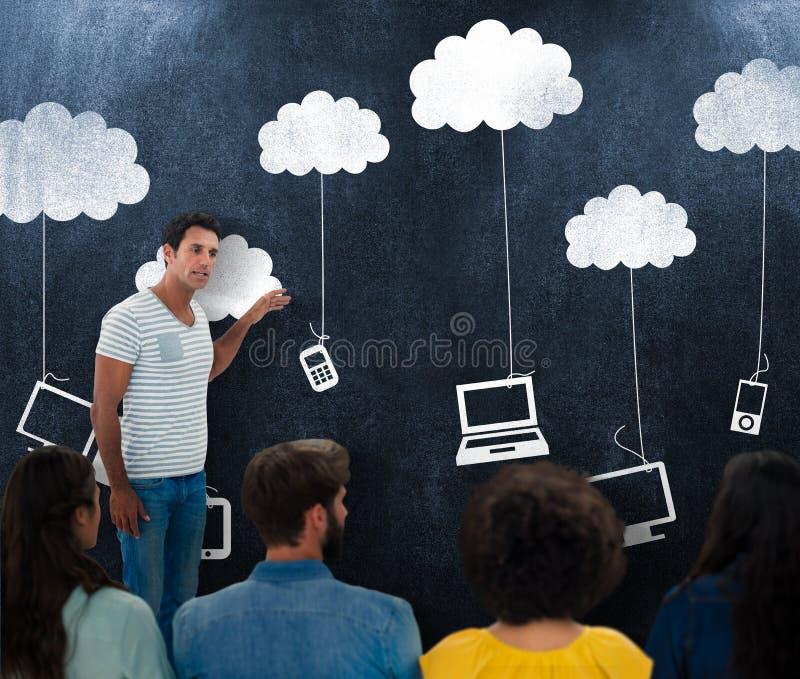 Составное изображение творческих бизнесменов на работе классн классным стоковое изображение