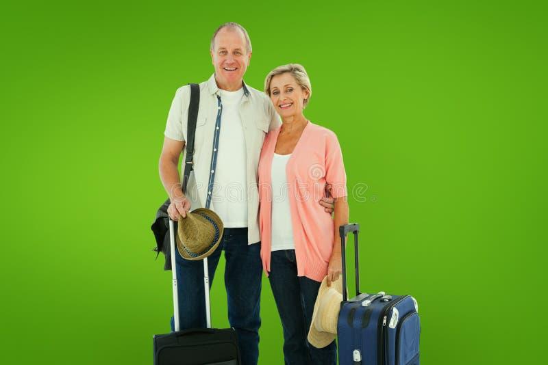 Составное изображение усмехаясь более старых пар идя на их праздники стоковые изображения rf
