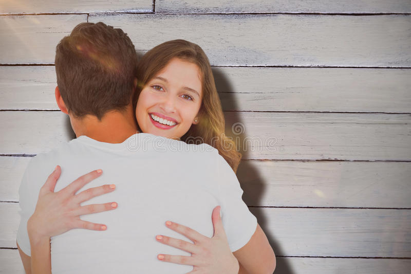 Составное изображение усмехаясь молодой женщины обнимая человека стоковые фотографии rf