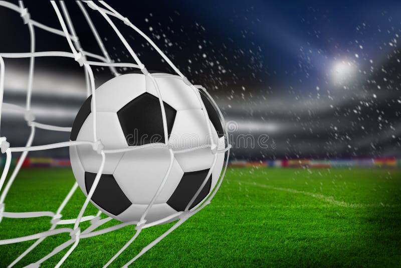 Составное изображение футбольного мяча в сети цели стоковые изображения rf