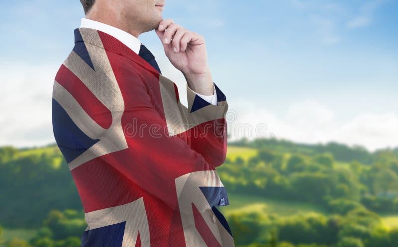 Составное изображение элегантного бизнесмена в представлять костюма стоковое изображение rf
