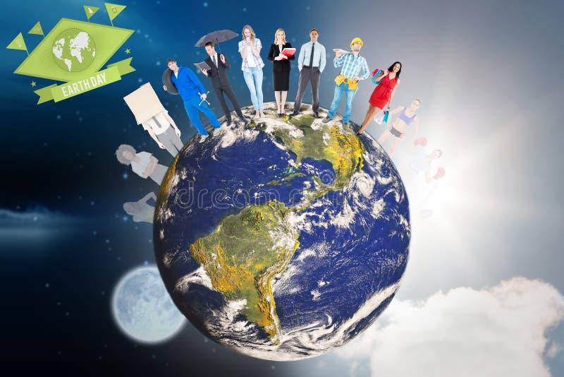 Составное изображение людей стоя на мире стоковое фото rf