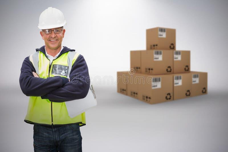 Составное изображение 3d работника нося трудную шляпу в складе стоковая фотография rf