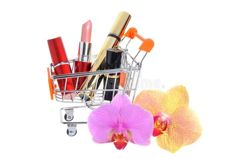 Состав в pushcart с орхидеей цветет на белизне стоковые фото