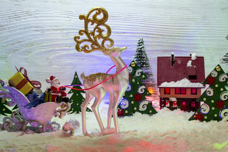 Состав праздника для рождества с Санта Клаусом в санях a стоковое фото rf