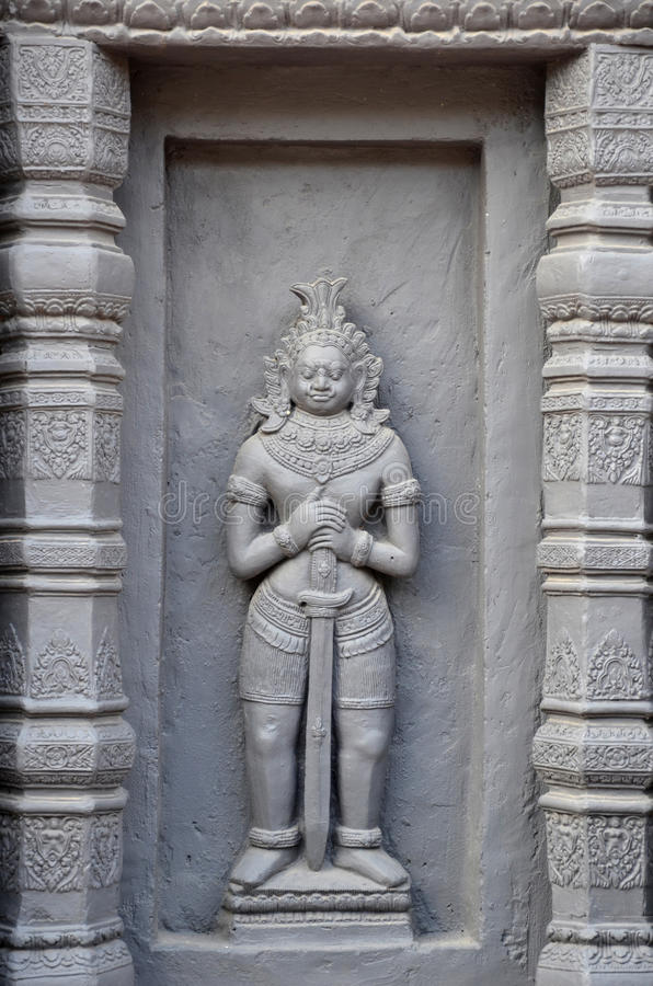 Состояние резного изображения Apsara на стене стоковые изображения rf