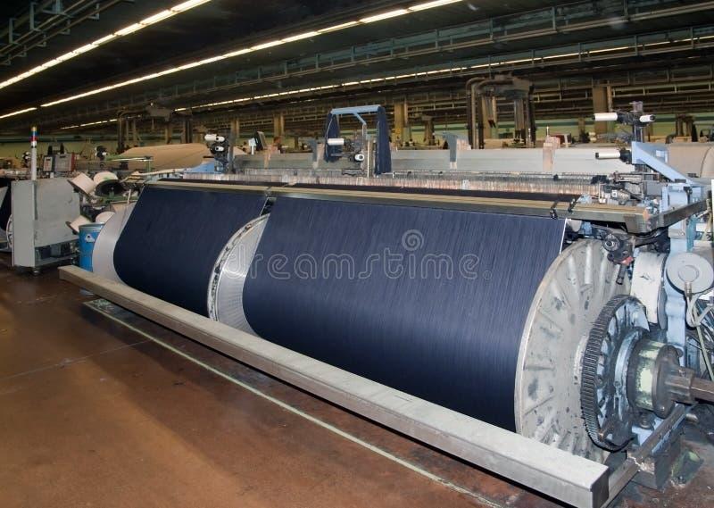соткать тканья индустрии джинсовой ткани стоковые изображения