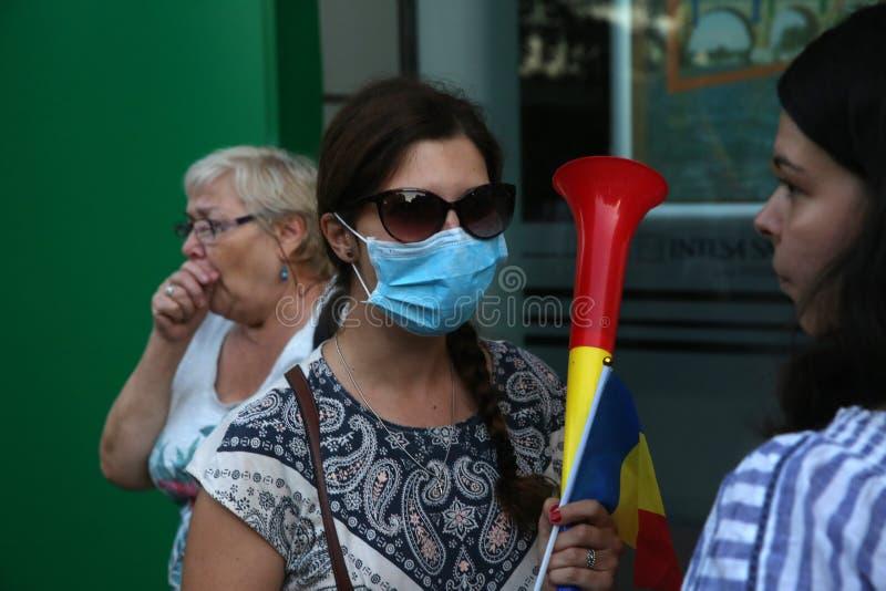 Сотни раненые в протестах Румынии стоковое фото