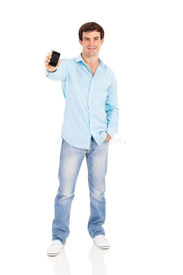 Сотовый телефон человека стоковая фотография
