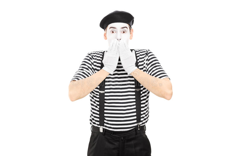 Сотрясенный художник пантомимы стоя в неверии стоковые изображения rf