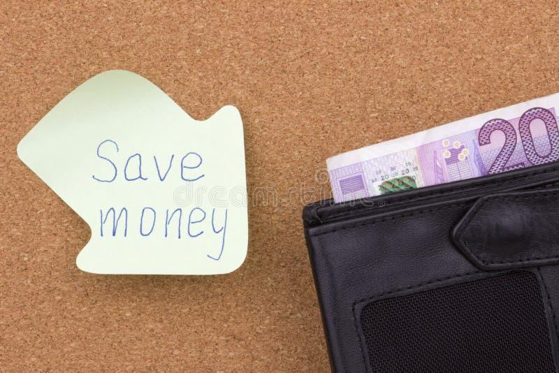 Сохраньте деньги написанные на липком примечании стоковая фотография rf
