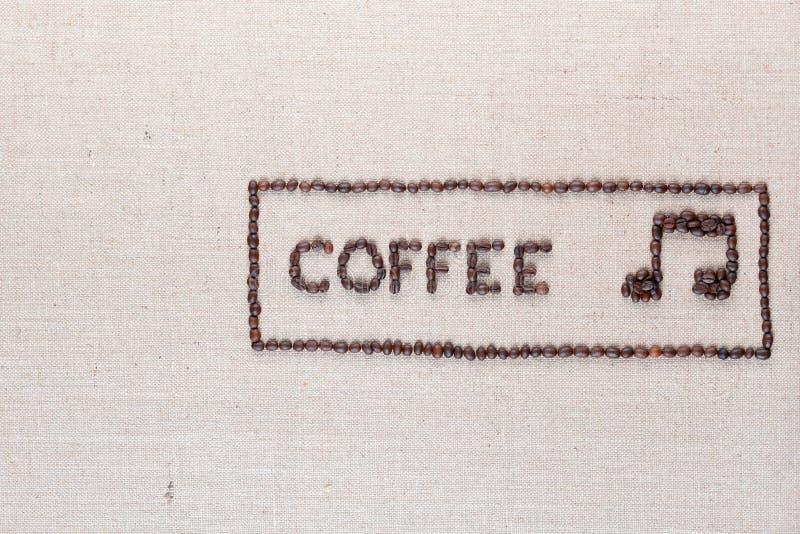 Сочинительство и примечание кофе в рамке, аранжированном среднем праве стоковая фотография