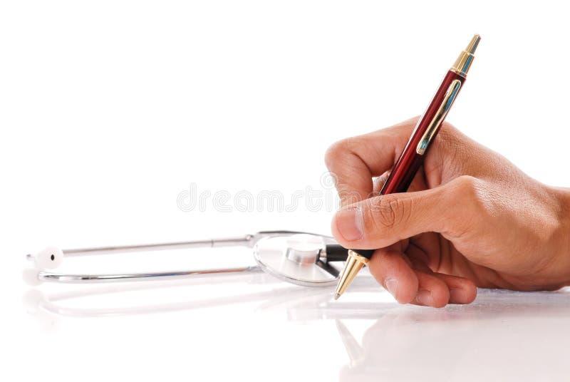 сочинительство руки стоковая фотография