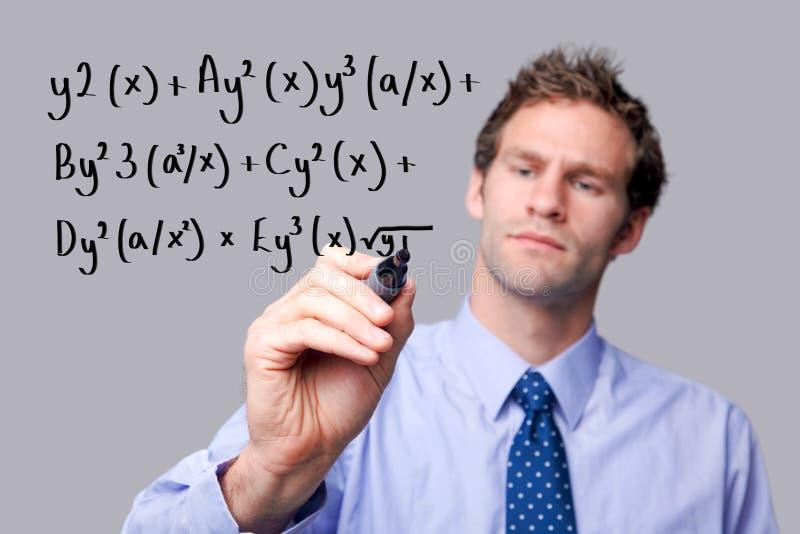 сочинительство учителя математик уровнения стоковое фото rf