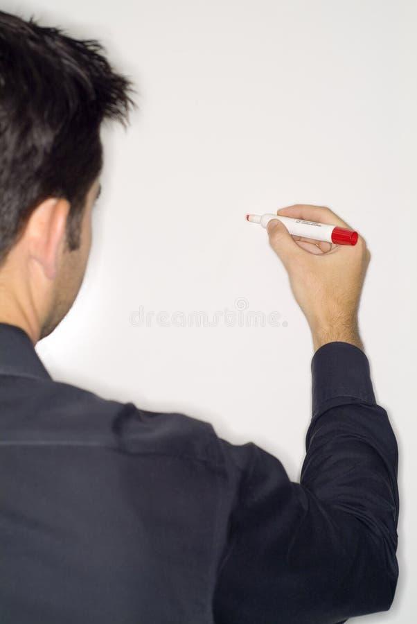 сочинительство человека erase доски сухое стоковое изображение rf