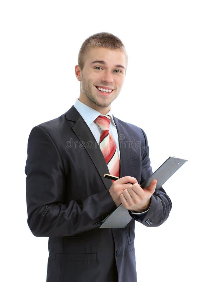 сочинительство clipboard бизнесмена стоковое фото