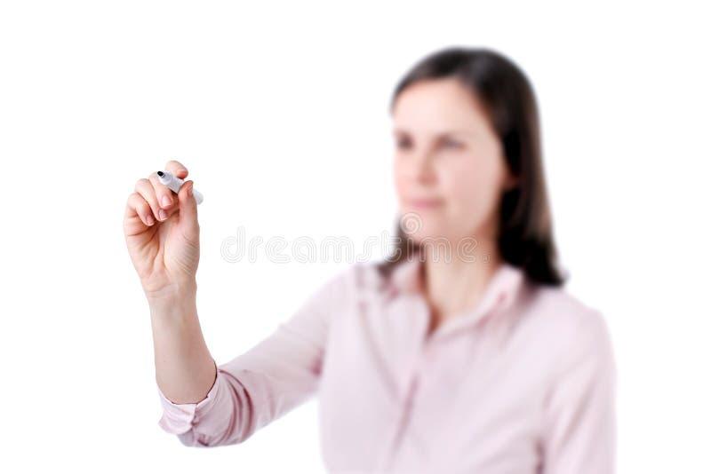 Сочинительство дела молодой женщины что-то, на экране изолированном на белой предпосылке. стоковое изображение