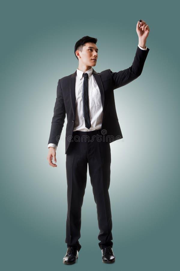 Сочинительство или чертеж бизнесмена стоковые фото