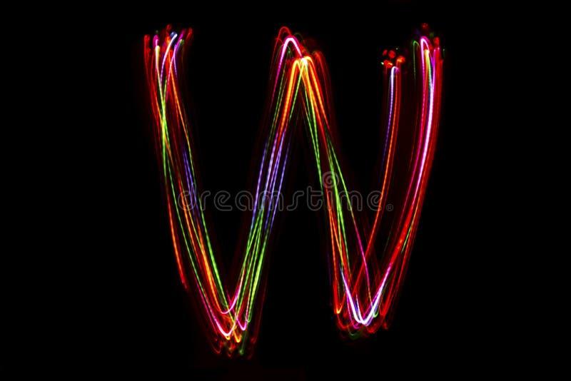 Сочинительство ` w ` слова от света стоковое изображение rf