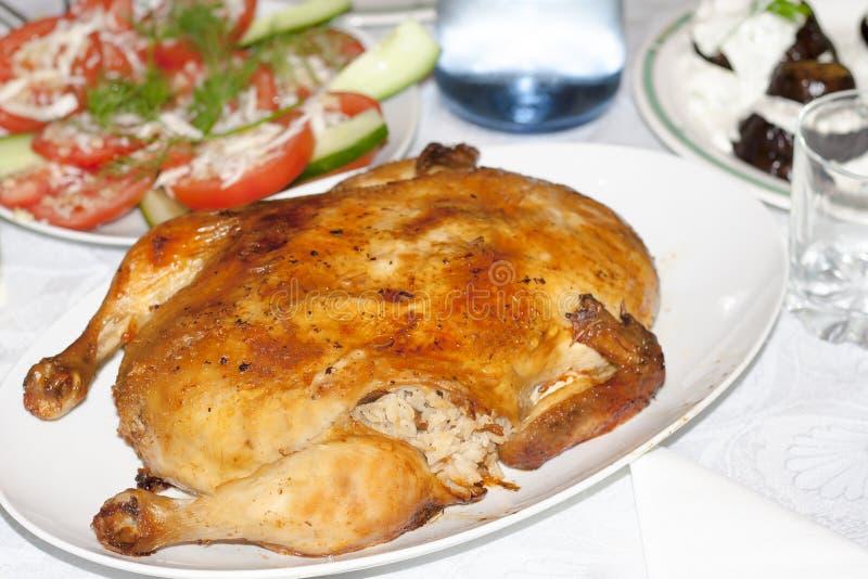 Сочный цыпленок заполненный с рисом стоковые фото