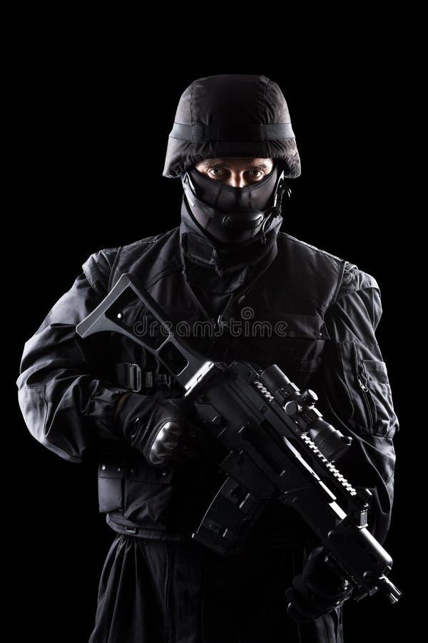 Солдат ops спецификаций на черной предпосылке стоковые изображения rf