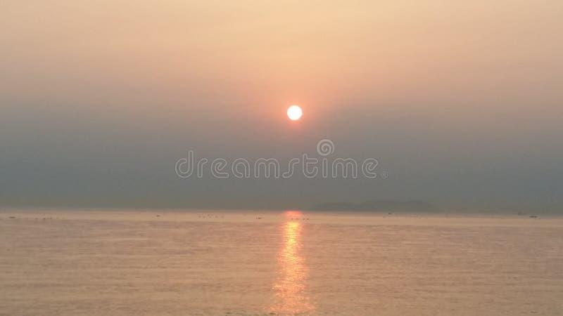 Солнце утра на море стоковое фото rf