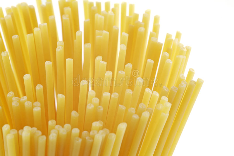 спагетти макаронных изделия uncooked стоковая фотография rf
