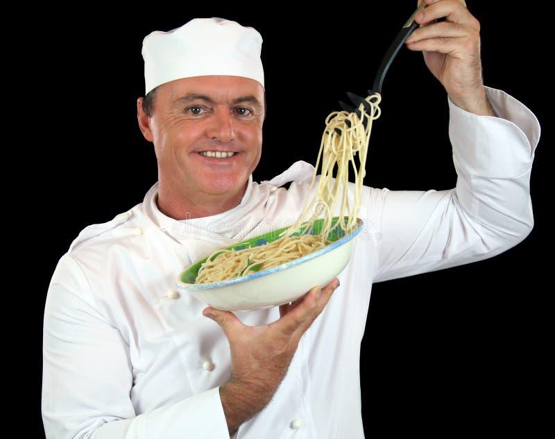 спагетти шеф-повара стоковые изображения