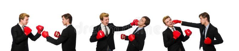 Спарите бизнесменов кладя в коробку на белизне стоковая фотография rf