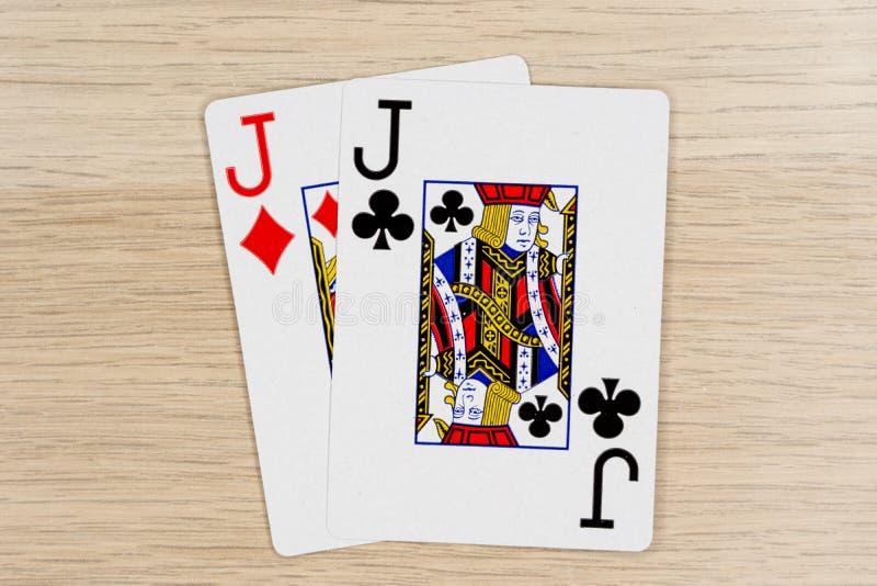 Спарите поднимает - казино домкратом играя карты покера стоковое изображение