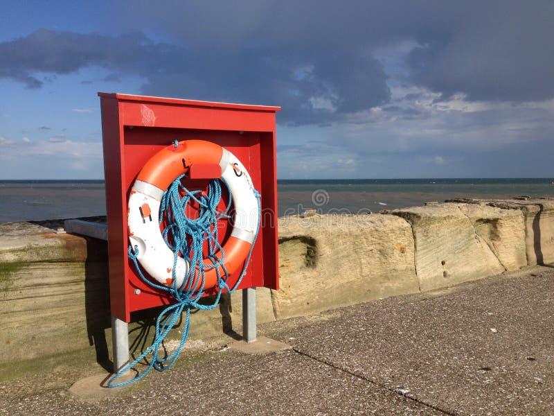 Спасательный пояс на пристани стоковое фото