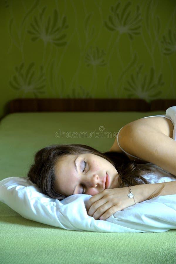 Спать женщина стоковые фото